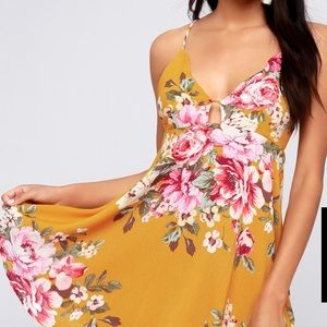 Mustard yellow floral mini dress. New with Tag.